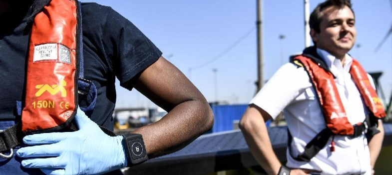 Port workers with smart bracelet